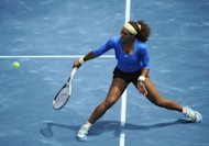 American Serena Williams returns a ball to Czech Lucie Hradecka during their semi-final match of the Madrid Masters. Williams won 7-6, 6-0