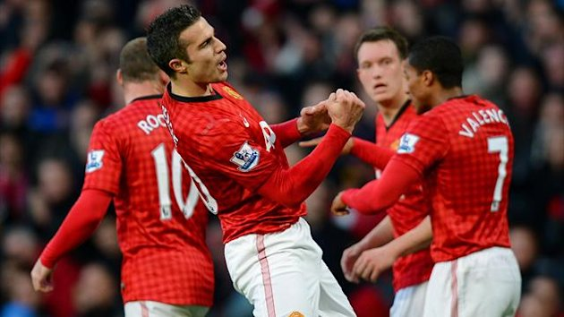 Manchester United's Dutch forward Robin van Persie (2-L) celebrates after scoring the first goal during the English Premier League football match between Manchester United and Sunderland at Old Trafford
