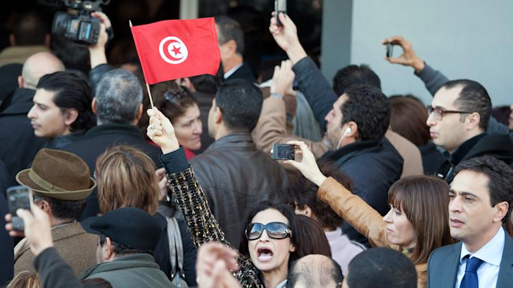 Tunisians demonstrate outside the home of Tunisian opposition leader Chokri Belaid after he was shot to death in Tunis, Wednesday, Feb. 6, 2013.  A critic of the Islamist-led government and violence by radical Muslims, Belaid was shot to death outside his home Wednesday, in the first political assassination in post-revolutionary Tunisia. The killing is likely to heighten tensions in the North African nation whose path from dictatorship to democracy so far has been seen as a model for the Arab world.  (AP Photo/Amine Landoulsi)