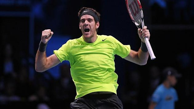 Argentina's Juan Martin Del Potro celebrates winning his men's singles tennis match against Switzerland's Roger Federer at the ATP World Tour Finals at the O2 Arena