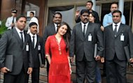 Indian Bollywood actress Kareena Kapoor (C) poses with celebrity bodyguards during the promotion of her new Hindi film 'Bodyguards' in Mumbai on August 31, 2011