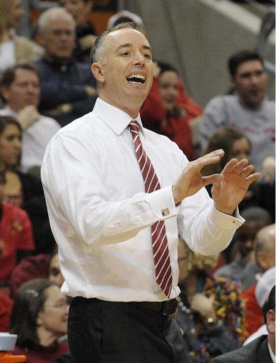 FILE - In this Dec. 23, 2011 file photo, Western Kentucky coach Ken McDonald shouts instructions to his team during the first half of their NCAA college basketball game against Louisville, in Louisvil
