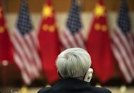 An official listens during US-China talks at the US Department of State, July 11, 2013 in Washington