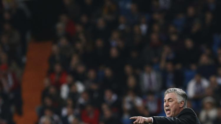 Real Madrid's coach Carlo Ancelotti gestures during their Spanish King's Cup soccer match against Osasuna at Santiago Bernabeu stadium in Madrid