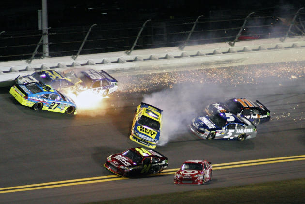 Paul Menard (27), David Ragan (34), Michael Waltrip (55) and Matt Kenseth (17) wreck coming out of Turn 1 during the NASCAR Budweiser Shootout auto race at Daytona International Speedway, Saturday, Fe