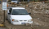A flood-destroyed car lies partially submerged in mud and debris in Jamestown, Colorado, after a flash flood destroyed much of the town, September 14, 2013. REUTERS/Rick Wilking
