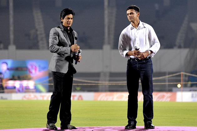 Indian Bollywood actor Shah Rukh Khan (L) and former Indian cricketer Rahul Dravid attend the grand opening ceremony of the Toyota University Cricket Championship (TUCC) first match of the season in M