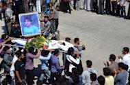 An image released by the Syrian opposition's Shaam News Network shows Syrians carrying the body of a youth allegedly killed in a Syrian government offensive, during his funeral in the town of Kfar Nubul in Idlib province. Army shelling and gunfire killed at least 28 civilians in protest towns, a watchdog said