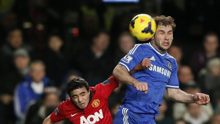 Chelsea's Ivanovic challenges Manchester United's Rafael during their English Premier League soccer match at Stamford Bridge