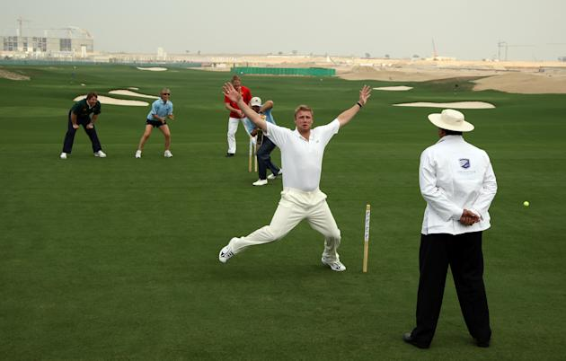 DUBAI, UNITED ARAB EMIRATES - JANUARY 28:  Andrew Flintoff of England on his return to cricket appeals loudly as he traps golfer Ernie Els of South Africa LBW, Flintoff is assisted in the field by spo