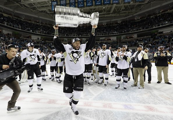 SAN JOSE, CA - JUNE 12: Matt Cullen #7 of the Pittsburgh Penguins celebrates with the Stanley Cup after their 3-1 victory to win the Stanley Cup against the San Jose Sharks in Game Six of the 2016 NHL Stanley Cup Final at SAP Center on June 12, 2016 in San Jose, California. (Photo by Bruce Bennett/Getty Images)