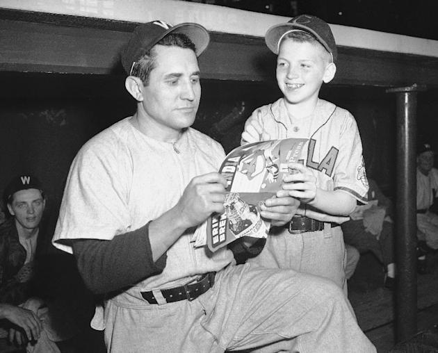 In this May 25, 1950, file photo, Washington Senators pitcher Canrado Marrero stands with Cleveland Indians bat boy Own McGinty, 12, in Cleveland. Marrero, the diminutive Cuban right-hander who pitche