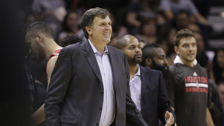 Houston Rockets head coach Kevin McHale, left, smiles as he greets his players during a timeout in the second half of a preseason NBA basketball game against the San Antonio Spurs, Thursday, Oct. 24, 2013, in San Antonio. Houston won 109-92