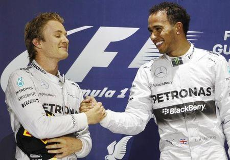 Hamilton of Britain is congratulated by Rosberg of Germany on the podium after he won the Bahrain F1 Grand Prix at the Bahrain International Circuit (BIC) in Sakhir