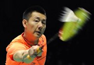 Chen Jin of China smashes a shot against compatriot Du Pengyu during their men's finals badminton match of the Asia Championships in China's northeastern coastal city of Qingdao. Chen moved closer to sealing his berth at the London Olympics by winning the men's singles title at the Asian Championships