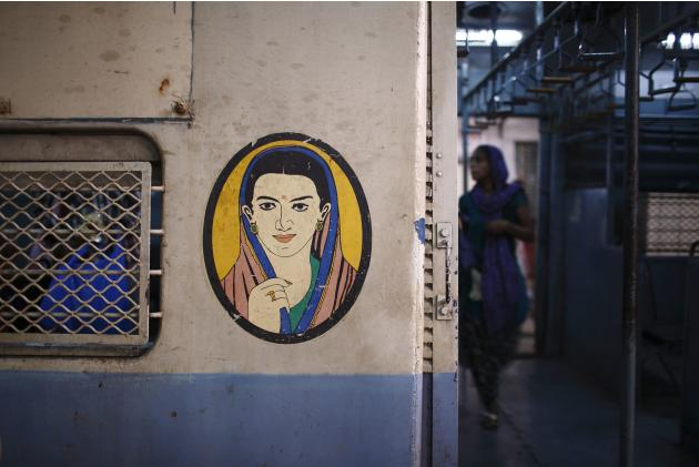 A portrait of a woman is seen near the entrance of the female compartment of a suburban train in Mumbai