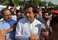 Pakistani politician Imran Khan (cenrte is greeted by supporters on the outskirts of Islamabad. Khan insisted a march to protest against US drone attacks -- a motorcade that included several thousand vehicles by the end, according to police -- was a success.