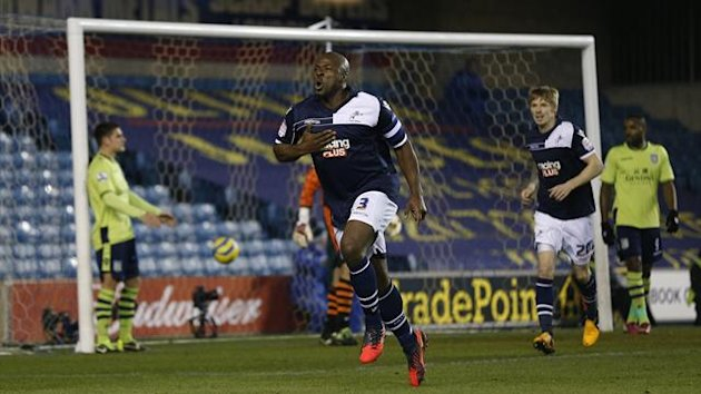 Millwall's Shittu celebrates his goal against Aston Villa during their FA Cup fourth round match at The Den in London