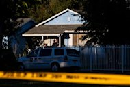 Sacramento Police investigators gather evidence at the scene of a shooting in Sacramento