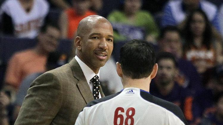 New Orleans Pelicans head coach Monty Williams, left, talks to NBA Official Marat Kogut in the first quarter during an NBA basketball game against the Phoenix Suns on Sunday, Nov. 10, 2013, in Phoenix