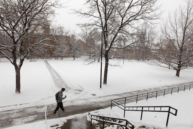 A student walks on the campus of the Univerisity of Colorado as a blizzard dropped snow over Boulder, Colo., Wednesday Dec. 19, 2012. A storm that has dumped more than a foot of snow in the Rocky Moun