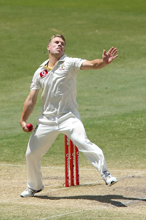ADELAIDE, AUSTRALIA - NOVEMBER 26:  David Warner of Australia bowls during day five of the Second Test Match between Australia and South Africa at Adelaide Oval on November 26, 2012 in Adelaide, Austr
