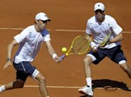 US brothers Mike (R) and Bob Bryan return the ball to Spain's Marcel Granollers and Marc Lopez during their Davis Cup semi-final doubles match at the Hermanos Castro park court in Gijon, northern Spain. The Bryan's won 6-3, 3-6, 7-5, 7-5