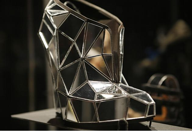 "This Feb. 11, 2013 photo shows a shoe, made of mirror fragments titled ""Invisible"", designed by Andreia Chaves, displayed at the ""Shoe Obsession"" exhibit at The Museum at the Fashion Institute of Tech"