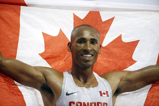 Damian Warner of Canada celebrates after he won the men's decathlon on July 23, 2015 in Toronto, Canada.  (Photo by Ezra Shaw/Getty Images)