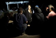 An image provided by the United Nations High Commission for Refugees (UNHCR) on September 10 shows US actress and UNHCR special envoy Angelina Jolie meeting refugees on the Jordanian border minutes after they crossed into the desert kingdom from Syria