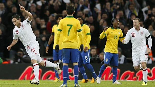 England's Frank Lampard (L) celebrates with team mate Wayne Rooney after scoring against Brazil during their international friendly soccer match at Wembley stadium in London February 6, 2013 (Reuters)