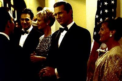 President Jackson Evans ( Jeff Bridges , center) greets Senator Reginald Webster ( Christian Slater ) at a state dinner with his Vice Presidential designate Senator Laine Hanson ( Joan Allen , left) and her husband William Hanson ( Robin Thomas , far left), at his side in Dreamworks' The Contender