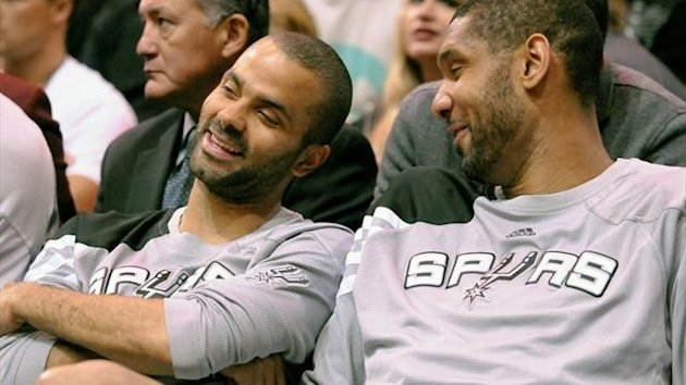 San Antonio Spurs point guard Tony Parker and center Tim Duncan talk on the bench (Reuters)