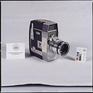 This image made available by the National Archives shows a 1963-1964 photograph of the movie camera used by Abraham Zapruder when he filmed the moment of the assassination of U.S. President John F. Kennedy on Nov. 22, 1963. Standing on a 4-foot-high concrete pedestal, his receptionist bracing him from behind, the 58-year-old Russian immigrant followed the progress of JFK's blue Lincoln limousine as it rolled toward him down Elm Street. (AP Photo/National Archives)