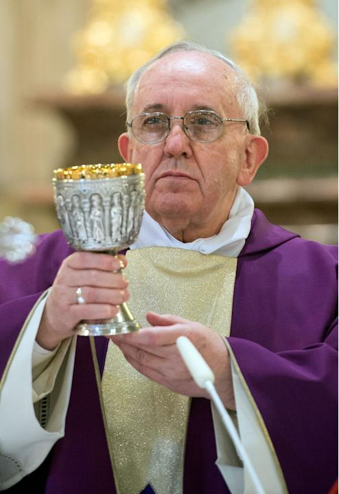 In this photo provided by the Vatican paper L'Osservatore Romano, Pope Francis celebrates Mass at the Vatican St. Anna parish church, Sunday, March 17, 2013. Pope Francis began his first Sunday as pon