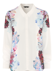 A white blouse balances the look.