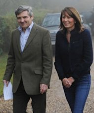 Carole and Michael Middleton outside their home near the village of Bucklebury, England, in November 2010, on the day their daughter's engagement to Prince William was announced. (Photo: Stefan Rousseau/AP)