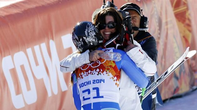 Slovenia's Tina Maze (front) hugs Switzerland's Dominique Gisin after they shared gold in the women's alpine skiing downhill race at the 2014 Sochi Winter Olympics February 12, 2014. REUTERS