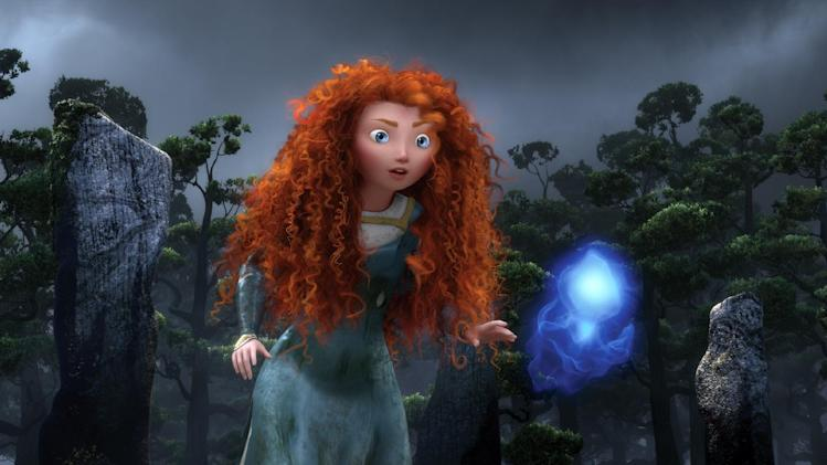 "This film image released by Disney/Pixar shows the character Merida, voiced by Kelly Macdonald, following a Wisp in a scene from ""Brave."" (AP Photo/Disney/Pixar)"