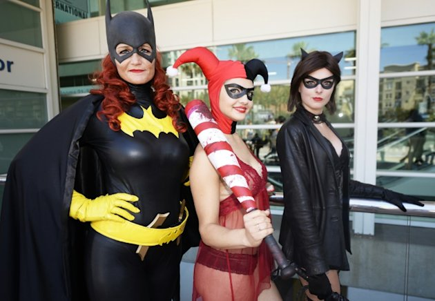 Attendees dressed as Batgirl, Harley Quinn and Catwoman pose on the first day of Comic-Con International in San Diego, California, July 9, 2015