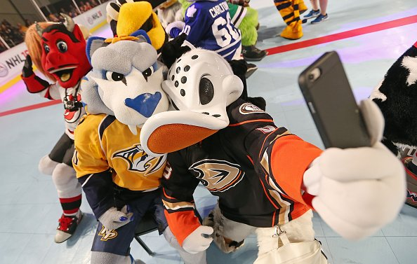 NASHVILLE, TN - JANUARY 28: NHL Mascots Wildwing and Gnash pose for a selfie during a game of musical chairs in the Mascot Showdown at the 2016 NHL Fan Fair at the Music City Center during the NHL Honda All-Star week in Nashville, Tennessee on January 28, 2016. (Photo by John Russell/NHLI via Getty Images)