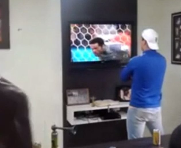 Delirious Brazil fan smashes telly during shoot-out