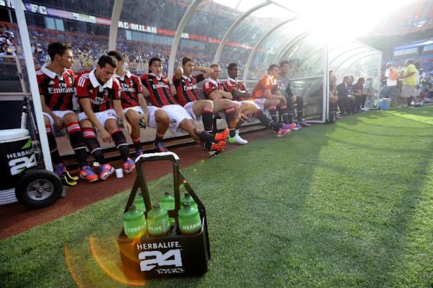 COMMERCIAL IMAGE - In this photograph taken by AP Images for Herbalife, A.C. Milan takes to their bench before the start of their game against Chelsea FC at the Herbalife World Football Challenge, Sat