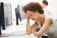 The Real Disadvantages of Overtime image woman tired at work pf 300x199