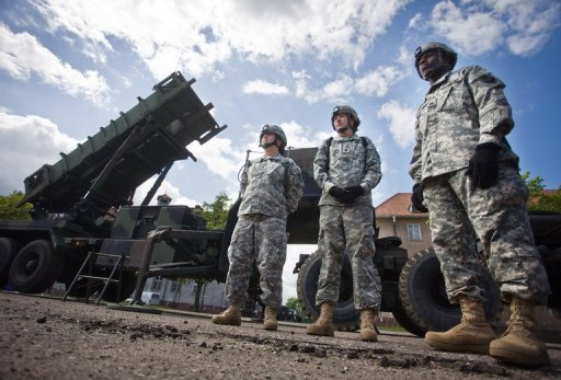 US soldiers stand in front of a Patriot missile battery at an army base in the northern Polish town of Morag in 2010. The German government said Thursday it had approved participation in a NATO mission to deploy Patriot missiles to help member state Turkey defend its border against Syria and will send up to 400 troops