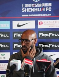 French striker Nicolas Anelka attends a press conference at Shanghai Shenhua Football Club on April 12, 2012. The Chinese Super League side said Anelka has been hired to help coach the team along with his playing duties