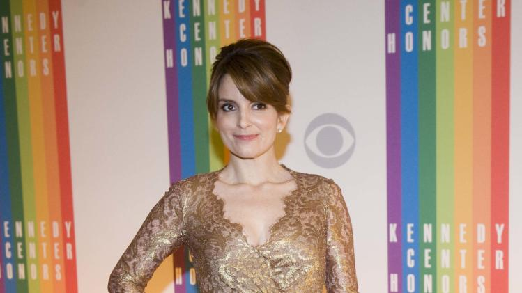 Actress Tina Fey arrives at the Kennedy Center for the Performing Arts for the 2012 Kennedy Center Honors Performance and Gala Sunday, Dec. 2, 2012 at the State Department in Washington. (AP Photo/Kevin Wolf)