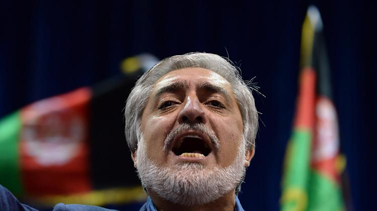 candidate Abdullah Abdullah speaks at a rally in Kabul on July 8, 2014