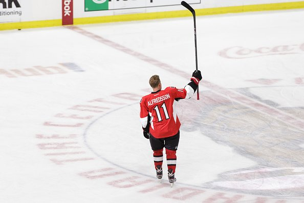 OTTAWA, ON - DECEMBER 4: Daniel Alfredsson #11 of the Ottawa Senators acknowledges the fans during warmups on the day he signed a one day contract and then announced his retirement prior to an NHL game against the New York Islanders at Canadian Tire Centre on December 4, 2014 in Ottawa, Ontario, Canada. (Photo by Jana Chytilova/Freestyle Photography/Getty Images)