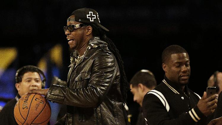 Rapper 2 Chainz, right, and Actor Kevin Hart walk on the floor before during the NBA All Star basketball game, Sunday, Feb. 16, 2014, in New Orleans
